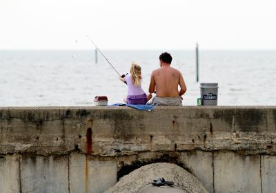 Father and daughter fishing on Gulf Coast